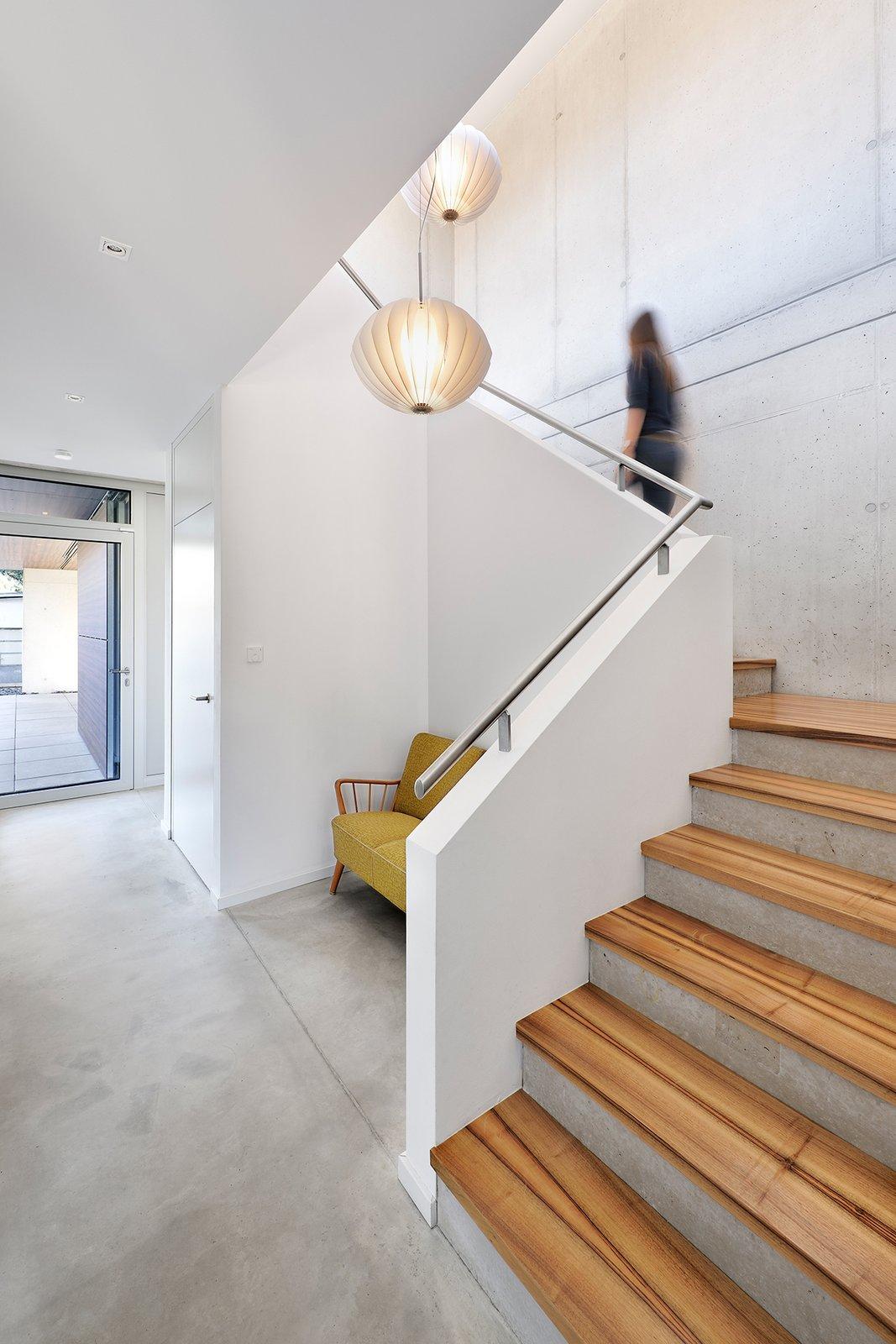 Staircase, Wood Tread, Concrete Tread, and Metal Railing Staircase with special wood decor.  House KI