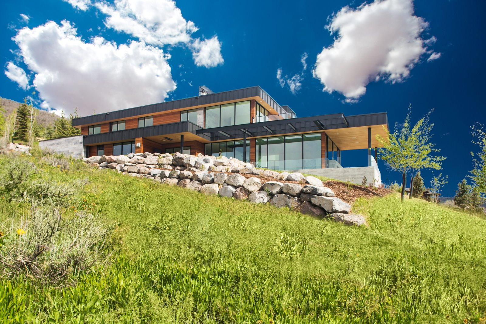 Exterior, Metal Roof Material, Stone Siding Material, House Building Type, Wood Siding Material, Metal Siding Material, and Flat RoofLine Built on just over an acre, no view is obstructed.  Purple Sage