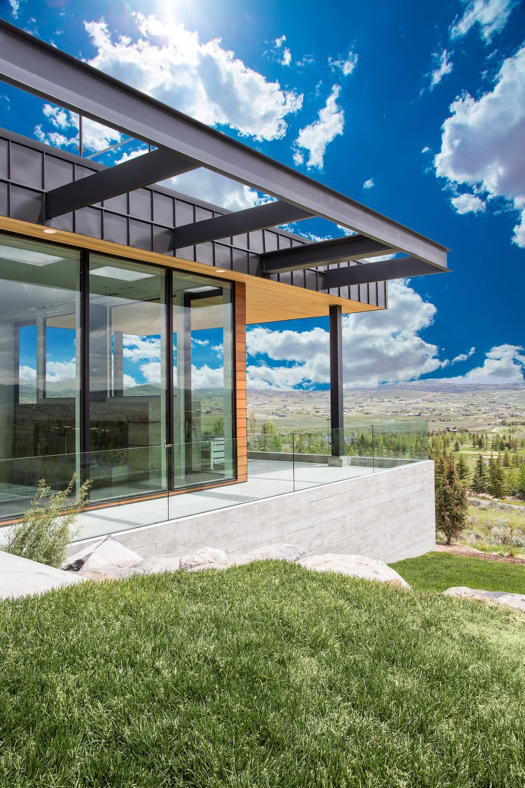 Outdoor, Large Patio, Porch, Deck, and Decking Patio, Porch, Deck A compilation of three exteriors keep the eye moving to appreciate its modern vibe.  Purple Sage
