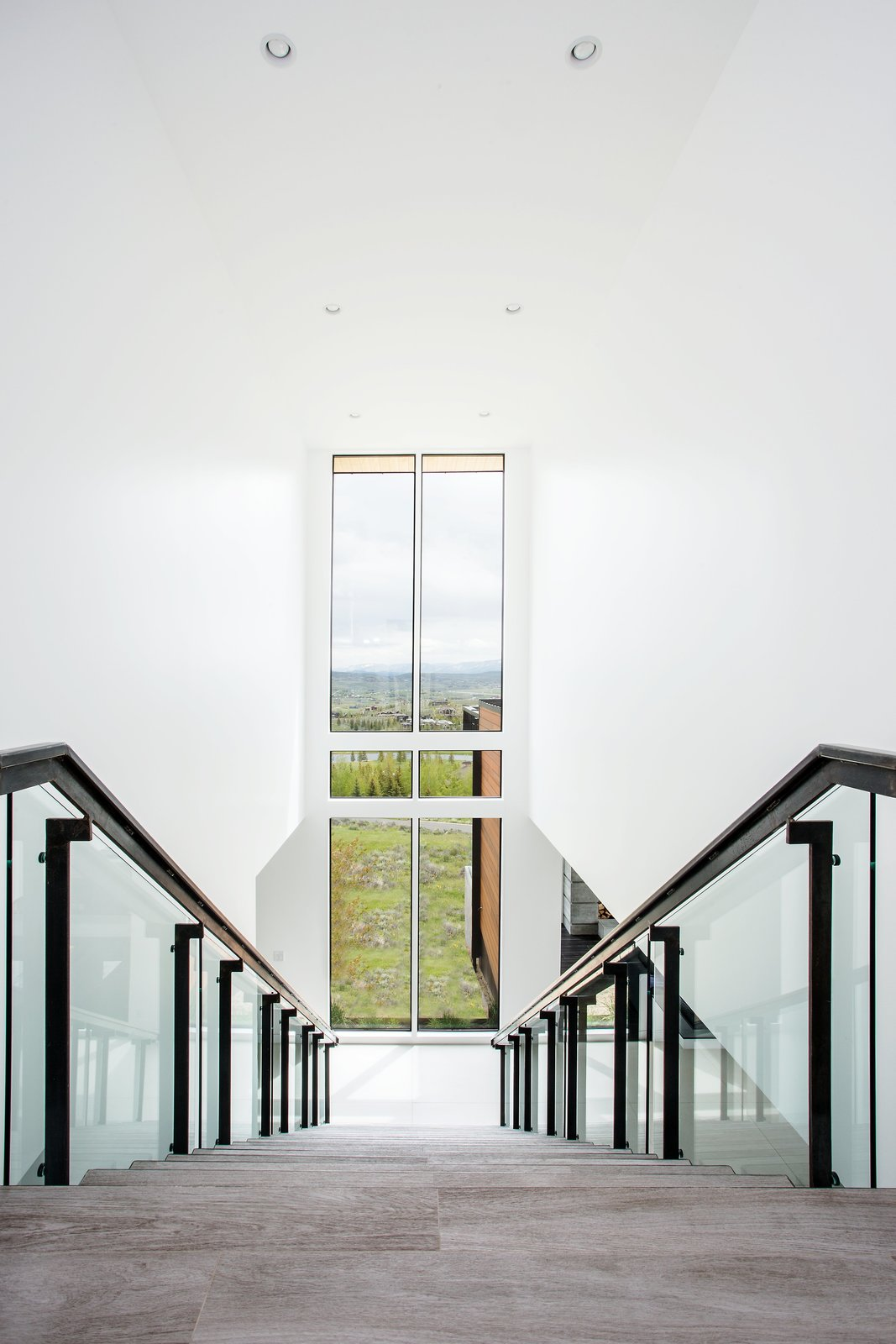 Staircase and Glass Railing Every step has a view with this two-story window.  Purple Sage