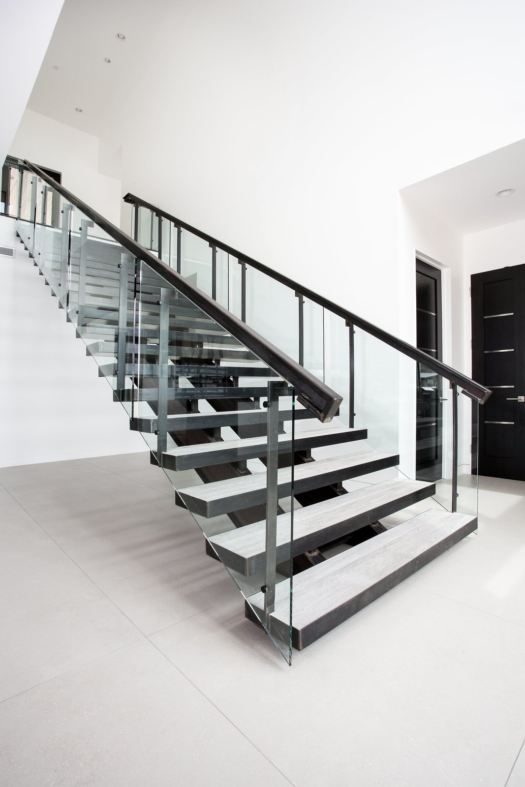 Staircase and Glass Railing A stunning, metal staircase is the most prominent of the two staircases in the home.   Purple Sage