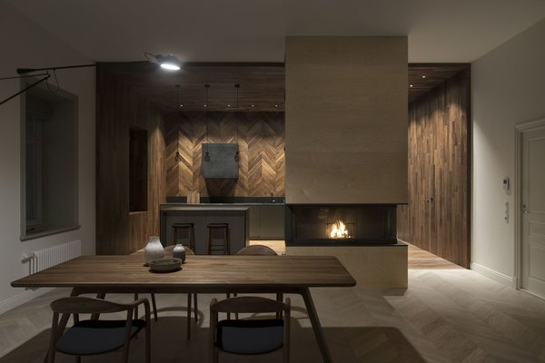 The custom-designed wood-burning fireplace was made in Italy.