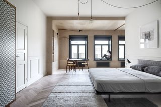 A shift in materials separates this bedroom from the breakfast area.