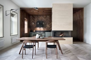 Light and dark herringbone parquetry combine to create a dynamic dining area.