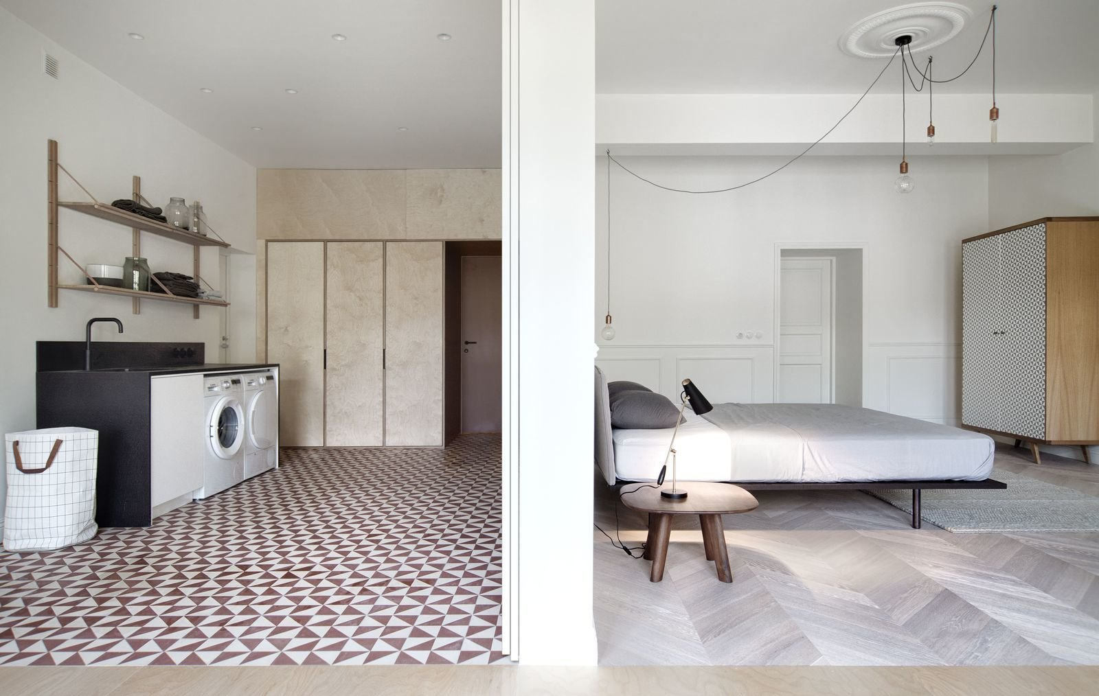 The bedroom and laundry room in INT2 architecture's Saint Petersburg Apartment