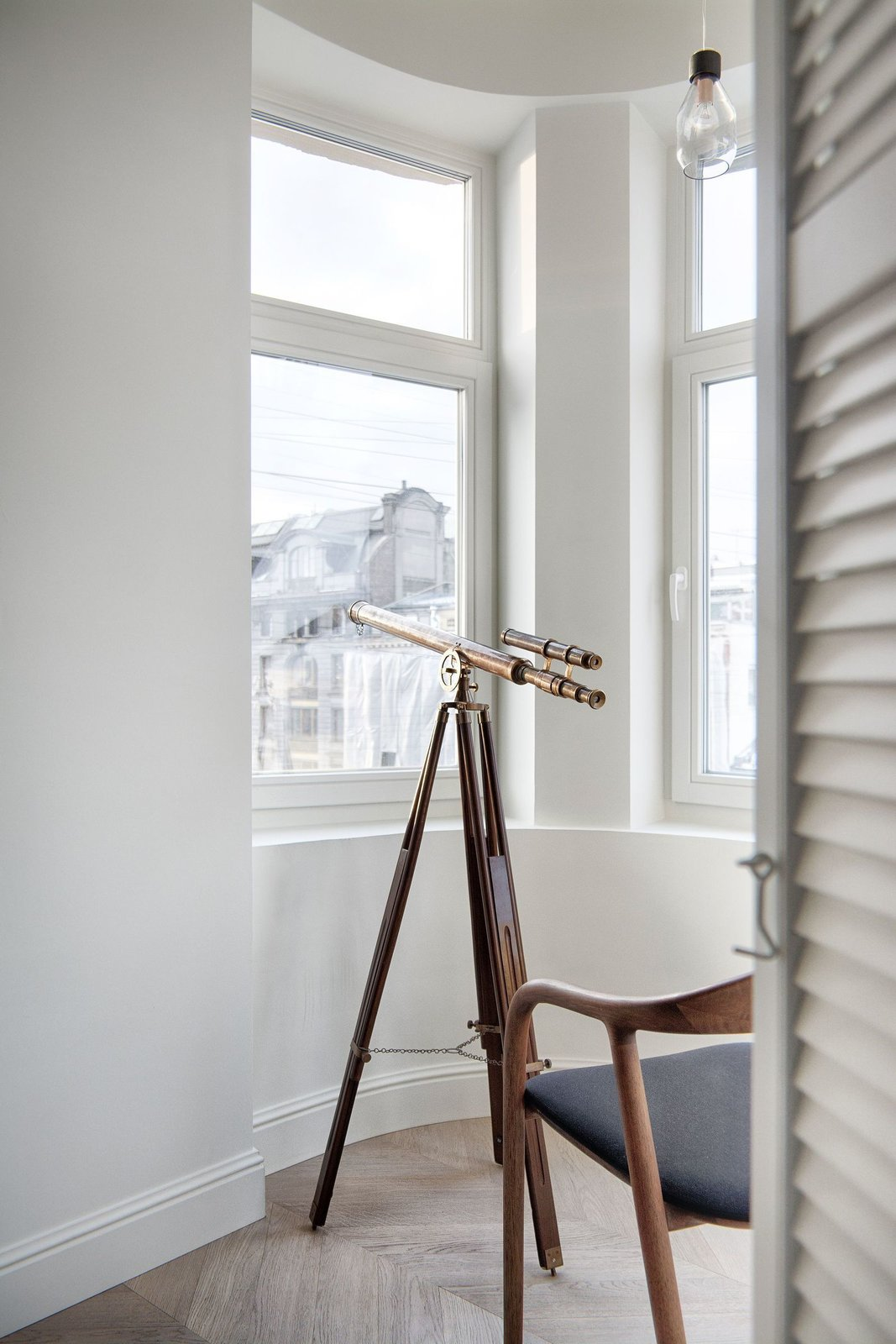 A telescope in the living area of INT2 architecture's Saint Petersburg Apartment