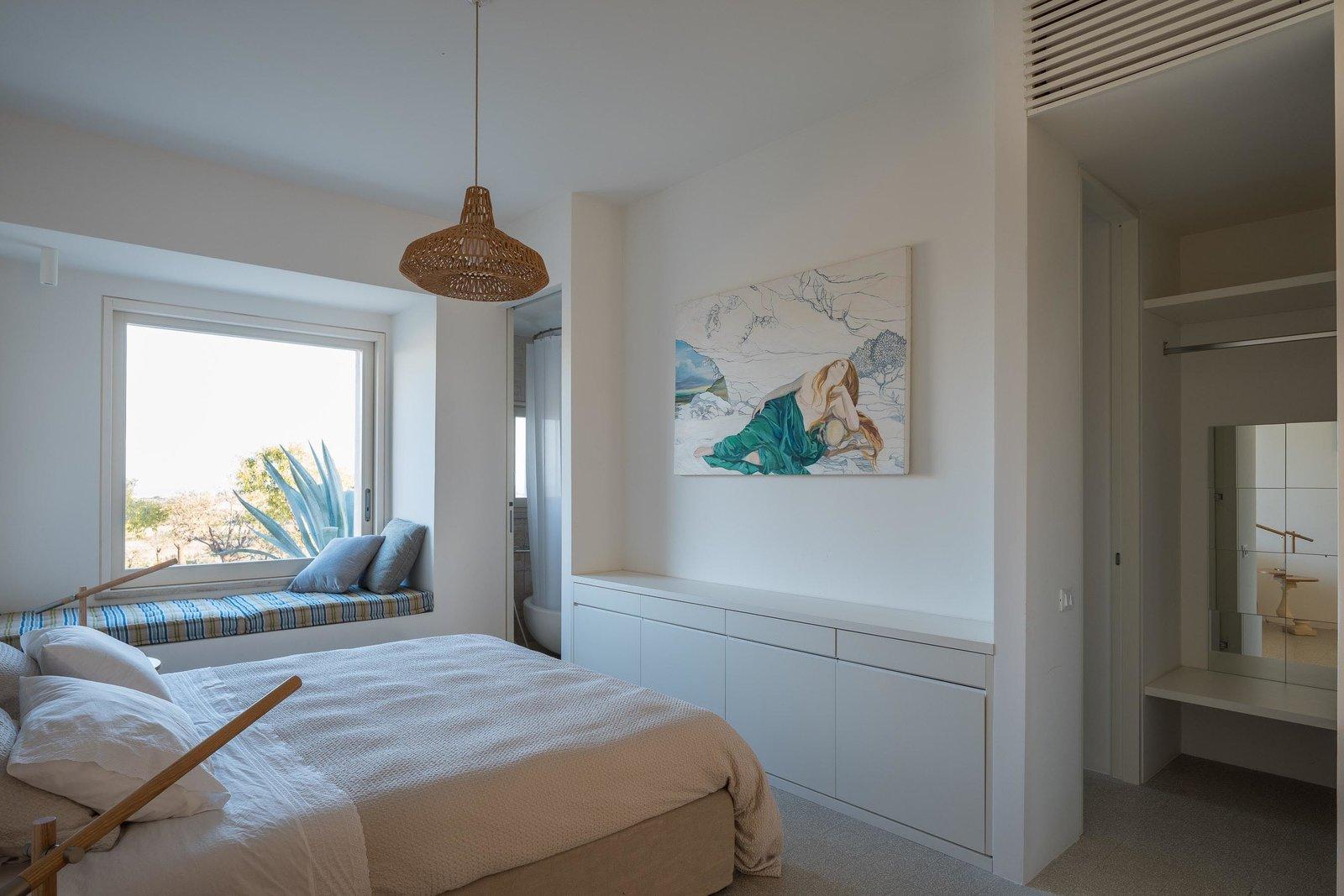 Bedroom, Pendant Lighting, Bed, Bench, and Wardrobe Master bedroom  Cozzo Coniglio
