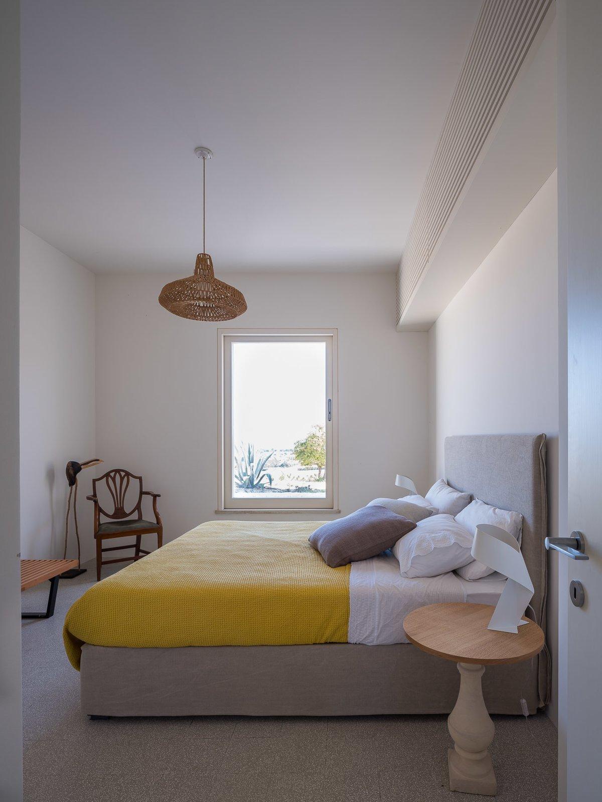 Bedroom, Chair, and Pendant Lighting Double bedroom  Cozzo Coniglio