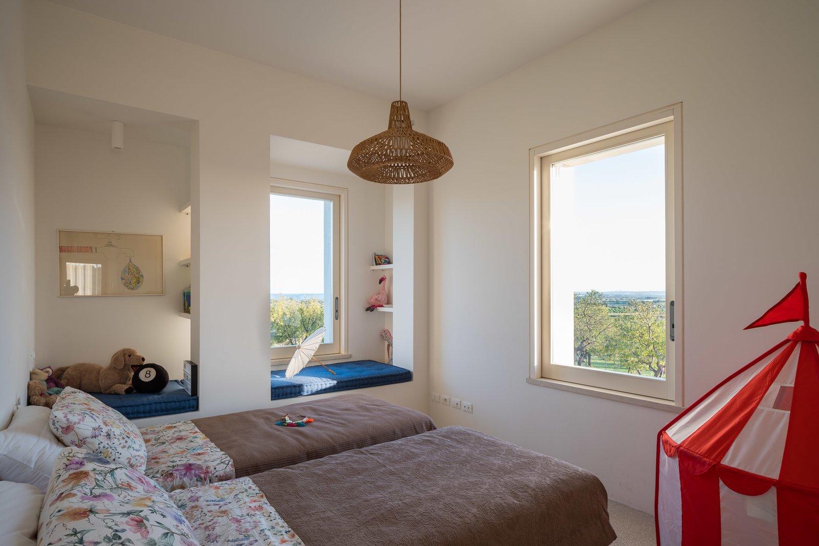 Bedroom, Pendant Lighting, Bench, and Bed Twin bedroom  Cozzo Coniglio