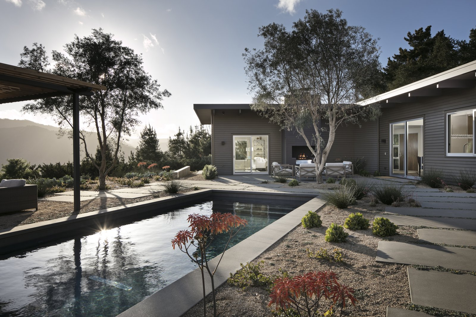 Exterior and House Building Type Backyard and outdoor living spaces, looking over the pool to the home and mountain views  Carmel Valley Vistas