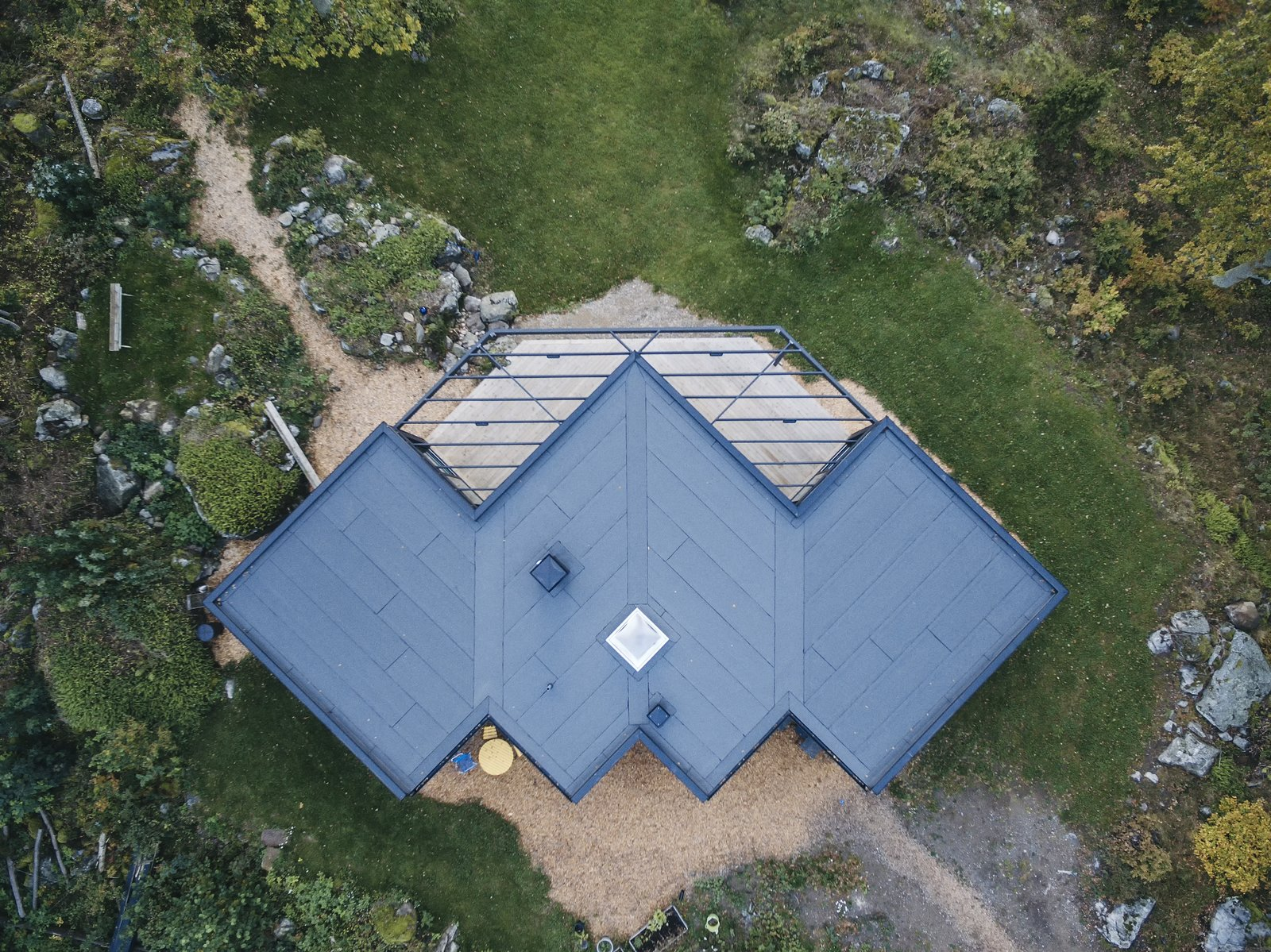 Exterior, Metal Roof Material, Flat RoofLine, Wood Siding Material, and House Building Type drone view  Best Photos from Villa G