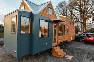 Tru Form Tiny merged two of their standard models and then further customized the exterior with paneling and tight knot cedar. They also added Galvalume roofing and a removable awning.