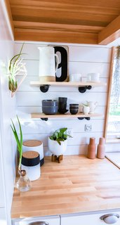 Open shelving gives the kitchen an airy feel.