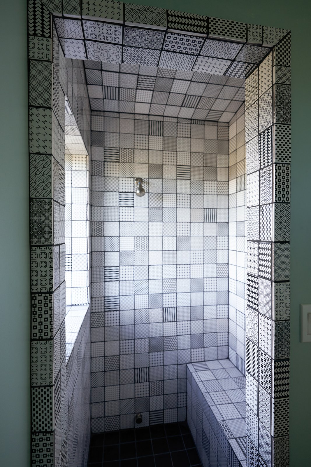 Bath Room, Ceramic Tile Wall, Ceramic Tile Floor, and Enclosed Shower Steam- bath shower with hand painted tiles designed by @aysemaria as part of the Geometric Series (www.ayse-design.com)  SkyNest by Joaquin Karcher