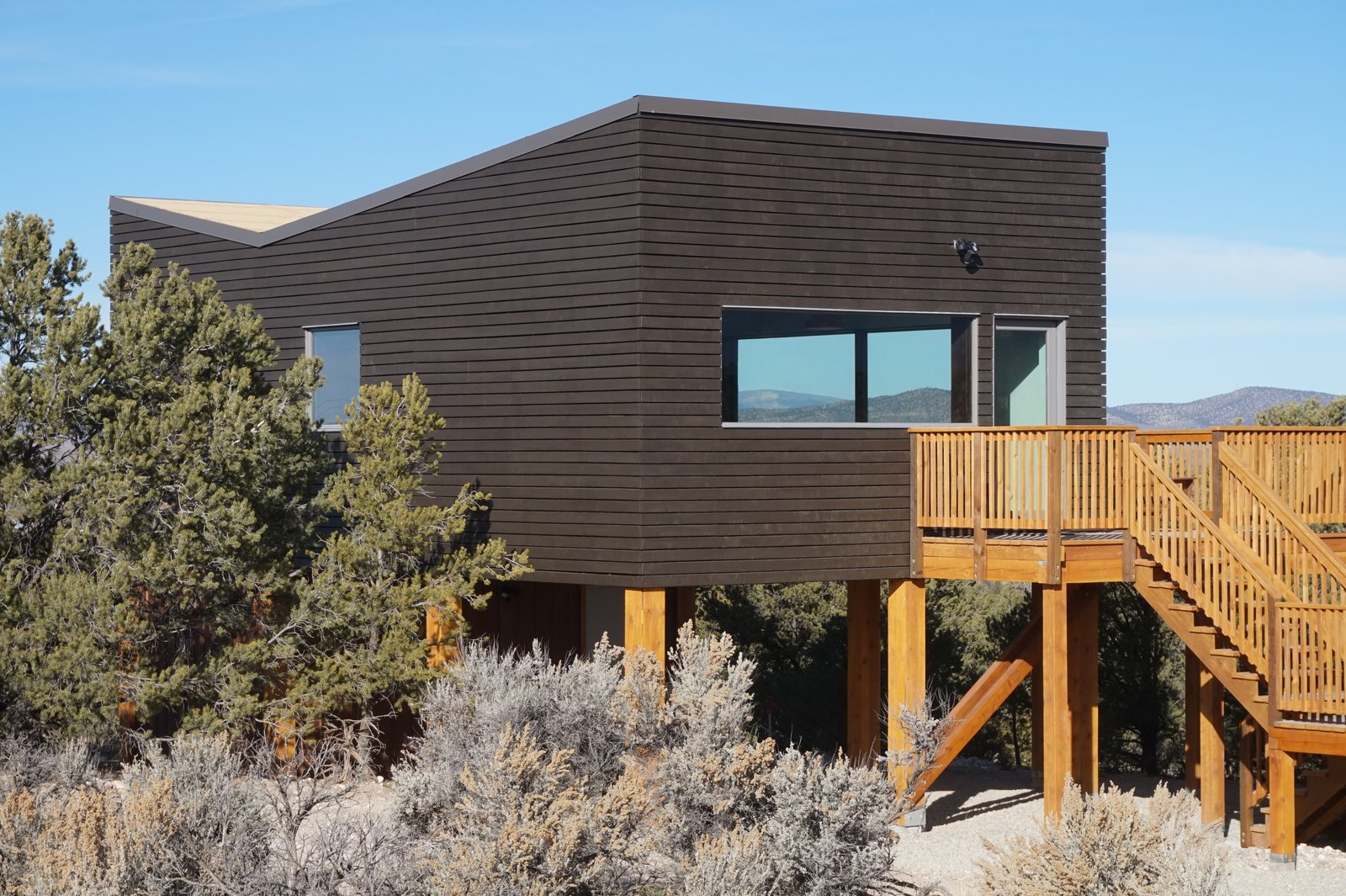 Exterior, Wood Siding Material, Green Roof Material, House Building Type, and Butterfly RoofLine Open joint wood siding cladding the super- insulated walls.  SkyNest by Joaquin Karcher