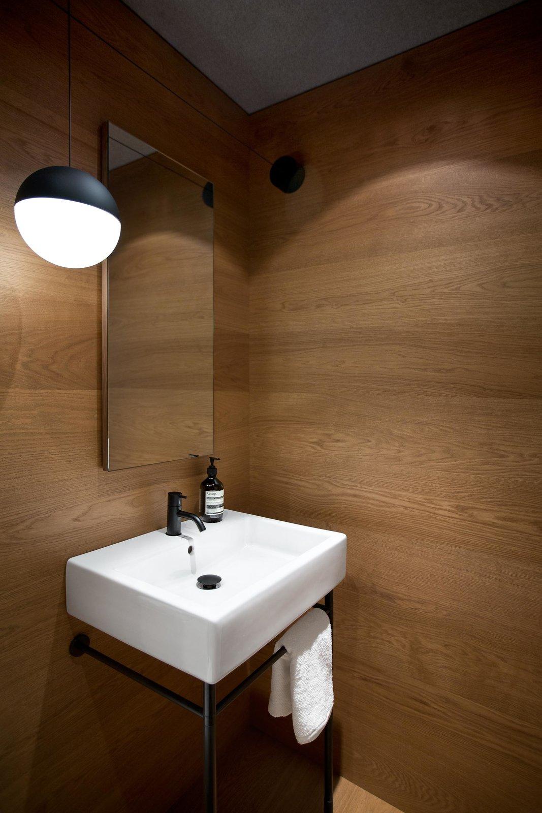 Bath, Medium Hardwood, Pedestal, Ceiling, and Pendant Duravit sink & pedestal, Vola faucet, Flos String Light pendant  Bath Medium Hardwood Ceiling Pendant Photos from Beatty Street Loft