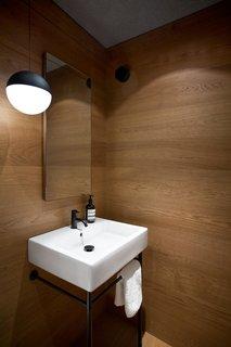 Duravit sink & pedestal, Vola faucet, Flos String Light pendant