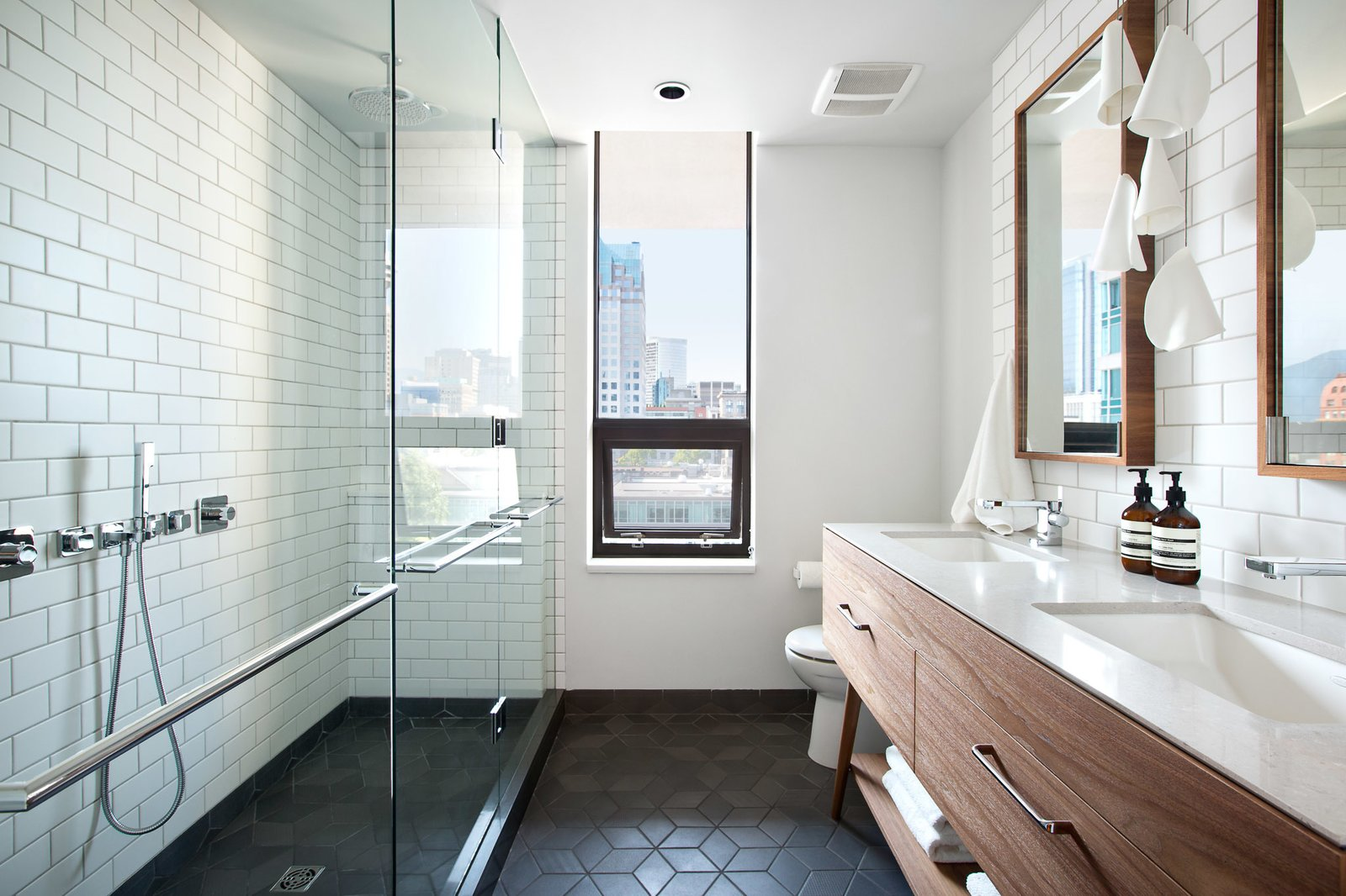 Bath, Subway Tile, Ceramic Tile, Undermount, Engineered Quartz, Ceiling, Pendant, and Enclosed Tex floor tile from Mutina, Custom walnut vanity, Bocci 21.5 pendant  Bath Engineered Quartz Ceramic Tile Pendant Photos from Beatty Street Loft