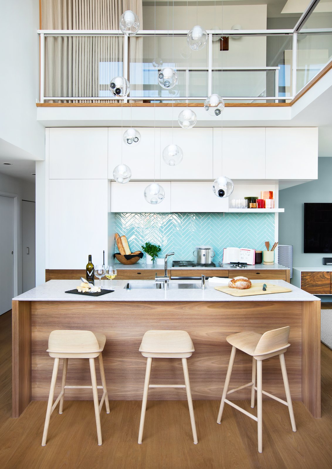 Kitchen, Wood, Refrigerator, Glass Tile, Wall Oven, Pendant, Undermount, Engineered Quartz, Medium Hardwood, Cooktops, Range Hood, and White Nerd Stools by Muuto  Best Kitchen Range Hood Wood Refrigerator Pendant Cooktops White Photos from Beatty Street Loft