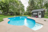 Modern home with Outdoor, Large Pools, Tubs, Shower, and Back Yard. Large custom pool with concrete deck, pool house and river rock gardens. There is a large barn and shed in the background outside the pool enclosure. Photo 3 of The Empress