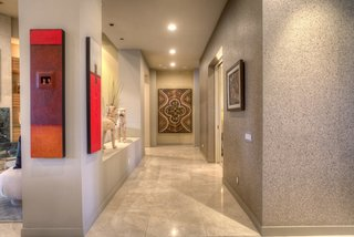 The  bronze cork covered corridor leading to the media room and bedrooms highlight the owners collection of worldly exotic art.