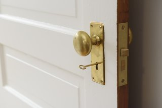 A brass doorknob paired with a mortice lock is a quintessential vintage look.