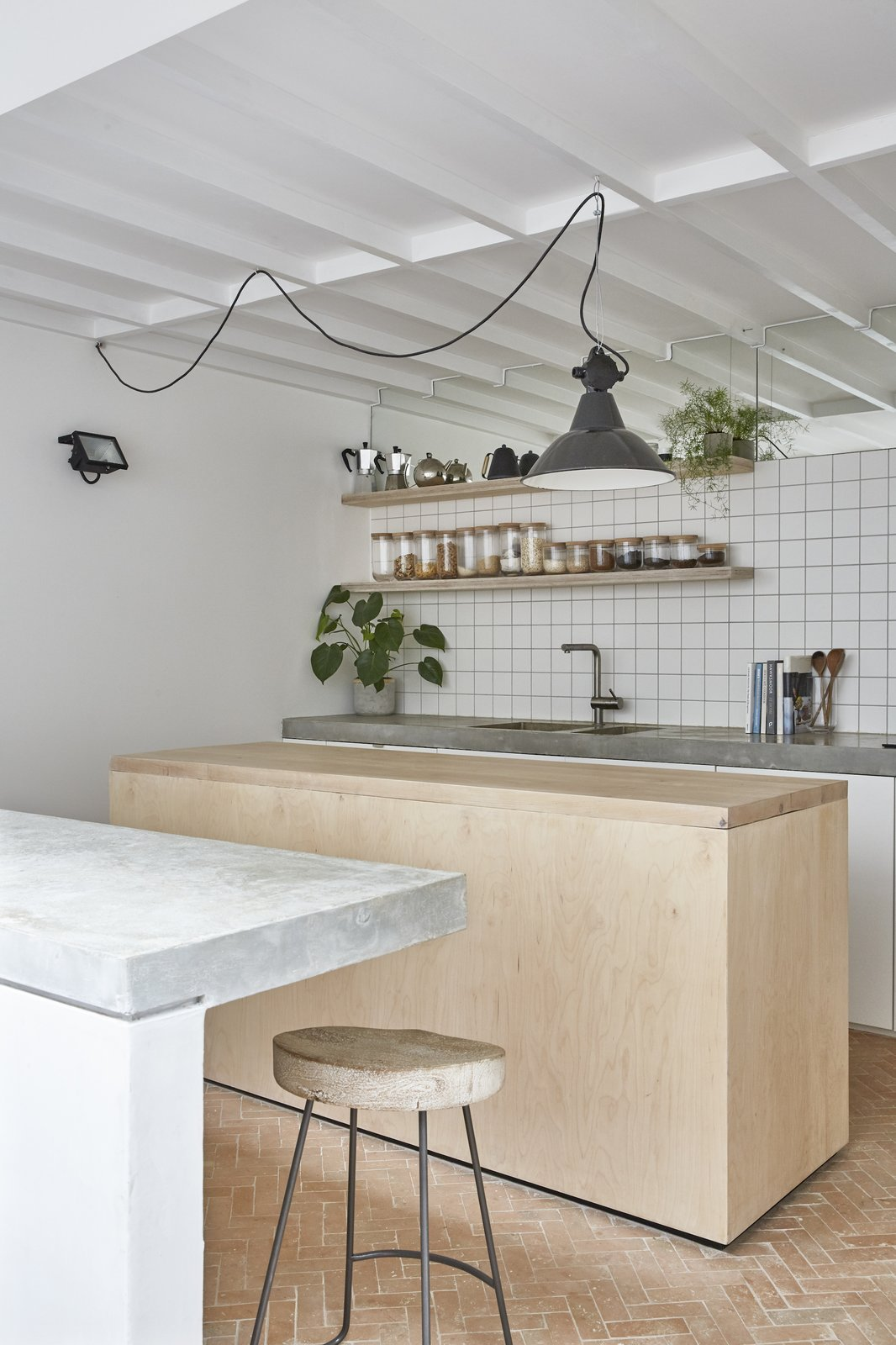 Kitchen, Wood Counter, Wood Cabinet, Drop In Sink, White Cabinet, Wall Lighting, Pendant Lighting, Ceramic Tile Floor, Ceramic Tile Backsplashe, and Concrete Counter Bespoke joinery, tiled finishes, concrete tops and high-level mirrors to the kitchen  Hackney Mews House by HUTCH design