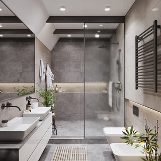 Two rectangle vessel sinks sit side-by-side across from two one-piece toilets in this bathroom, an absolute oasis of natural materials.
