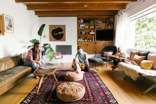 """Julia and Dusty Wheeler's family home in San Diego features a curated collection of handmade pieces, vintage treasures, global goods, and skateboarding memorabilia. The midcentury residence sports a classic """"Southern California cool"""" ambience."""