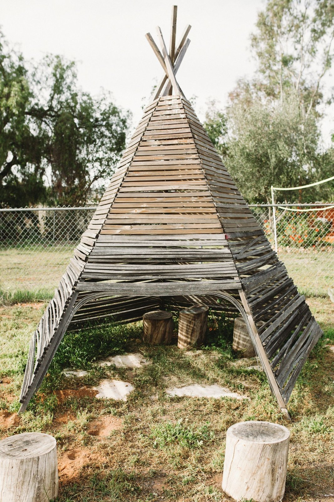 Outdoor, Grass, and Wire Fences, Wall The teepee is also handmade, and reflective of the earthy, bohemian, and yet kid-friendly style the Wheelers are all about.  Photos from Too Cool: This Boho Surf Shack Has a Half-Pipe in the Backyard
