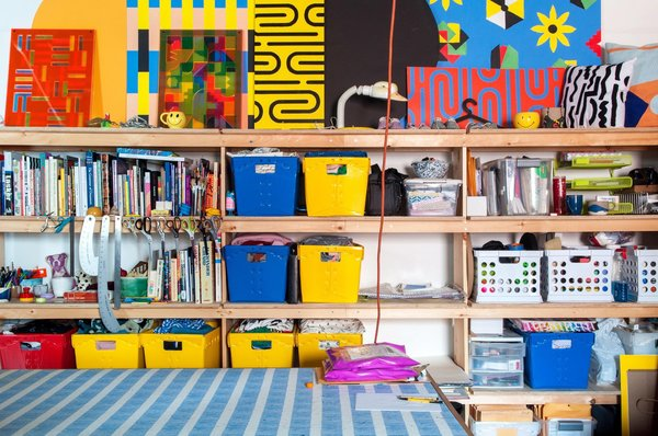 """While there is """"a lot of stuff around,"""" the busy, """"cluttered"""" studio doesn't feel sloppy. It's like a very colorful bomb went off but everything landed in a perfectly logical place."""