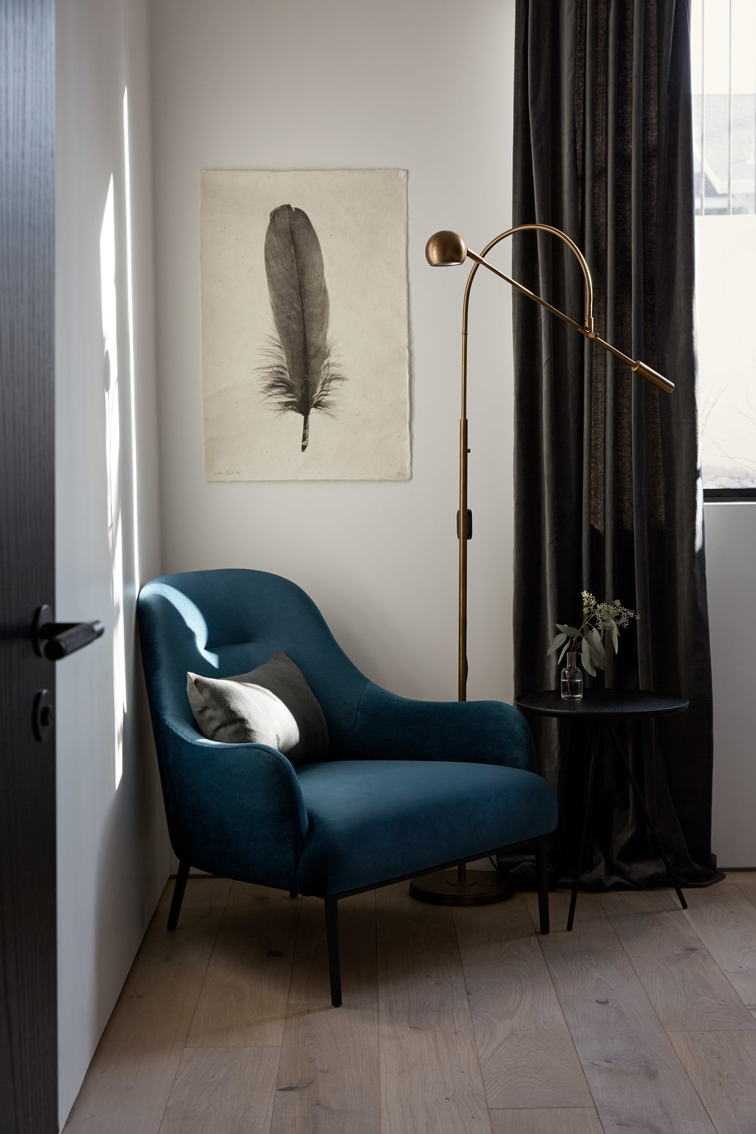 Bedroom, Light Hardwood Floor, Lamps, Night Stands, Bed, Floor Lighting, Ceiling Lighting, and Chair Blue velvet armchair with black stained oak side table in the guest room. Feather print on handmade Nepalese paper by an artist in Brooklyn, New York.  Normal Heights Residence