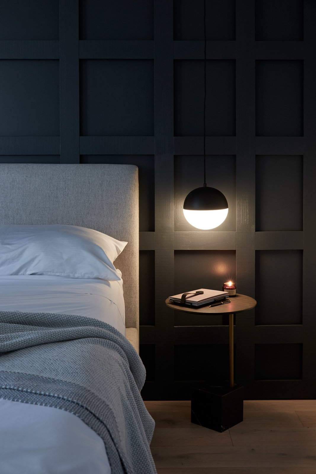 Bedroom, Bed, Night Stands, Pendant Lighting, and Light Hardwood Floor Contrasting black and white orb pendants on both sides of the bed provide warm light for bedtime reading or for writing in the guest journal.  Normal Heights Residence
