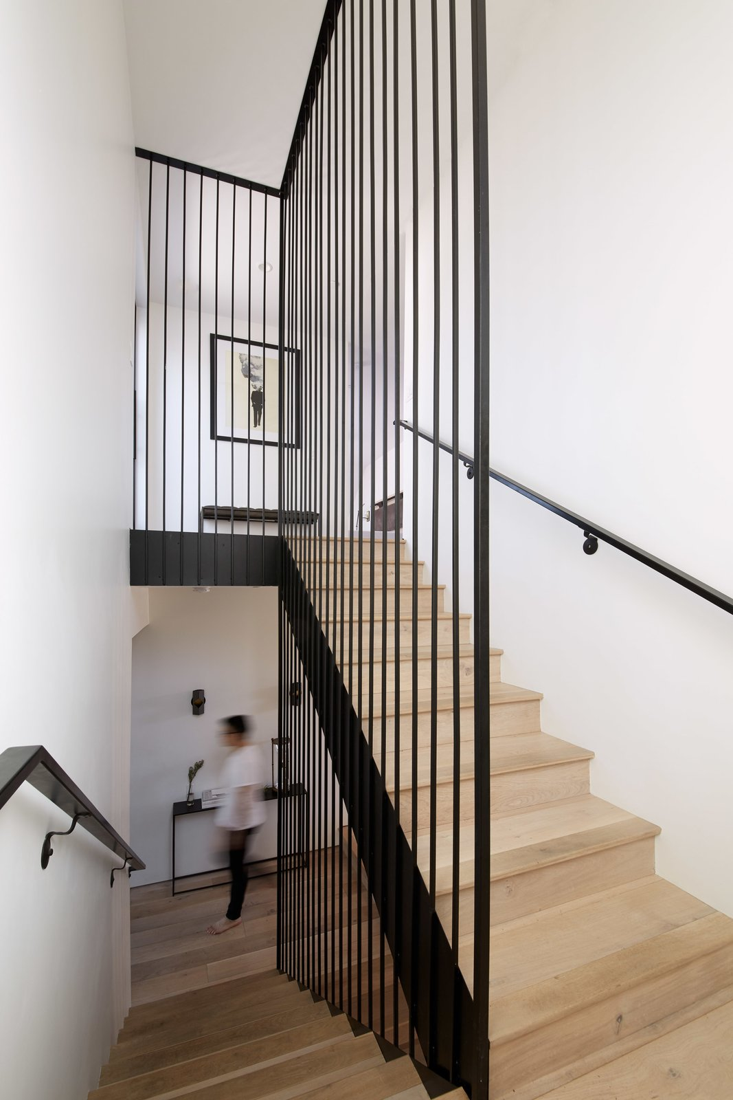 Staircase, Wood Tread, and Metal Railing The stairway showcases a guardrail with long, custom-made stair rods, which start from the basement and reach the second-floor ceiling.  Normal Heights Residence