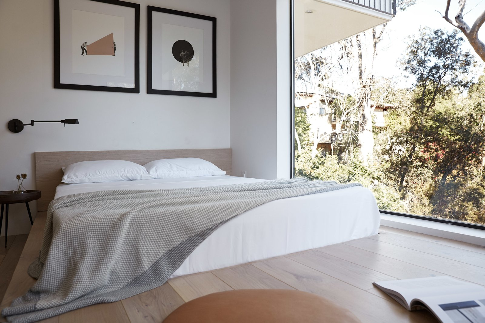 Bedroom, Bed, Light Hardwood Floor, and Wall Lighting The built-in platform bed transitions seamlessly from the headboard to the same white oak flooring. One large picture window provides plenty of natural light and a view of the valley.  Normal Heights Residence