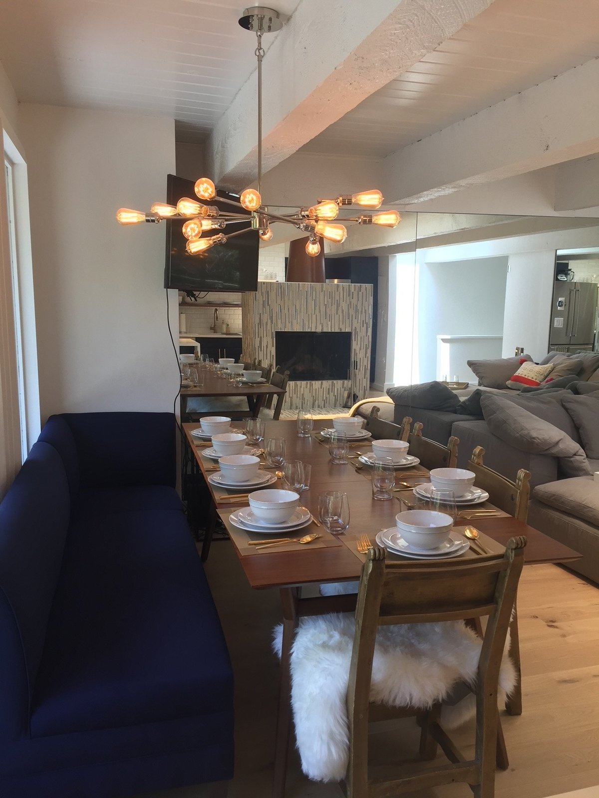 Dining Room, Light Hardwood Floor, Ceiling Lighting, Wood Burning Fireplace, Bar, Stools, Chair, Bench, and Table Plenty of seating  Modern Riverfront Townhouse in Aspen