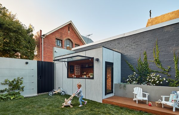 """FGR Architects designed an open, spacious home for a family to grow into in Victoria, Australia. Bloomfield House features an al fresco area and even a dedicated kids' area. """"Today, the family enjoys living in the space—we've seen a physical change in their lifestyle and wellbeing since moving in,"""" says director Feras Raffoul. """"A novelty cubby house at the back also provides endless fun for children of the house."""""""