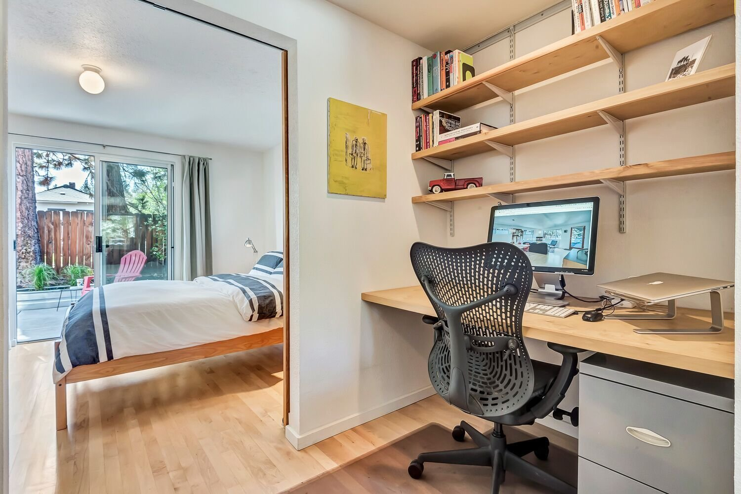 Office, Light Hardwood Floor, Shelves, Bookcase, Study Room Type, Chair, and Desk Two identical office spaces make it easy to work from home.   The Mod Ranch