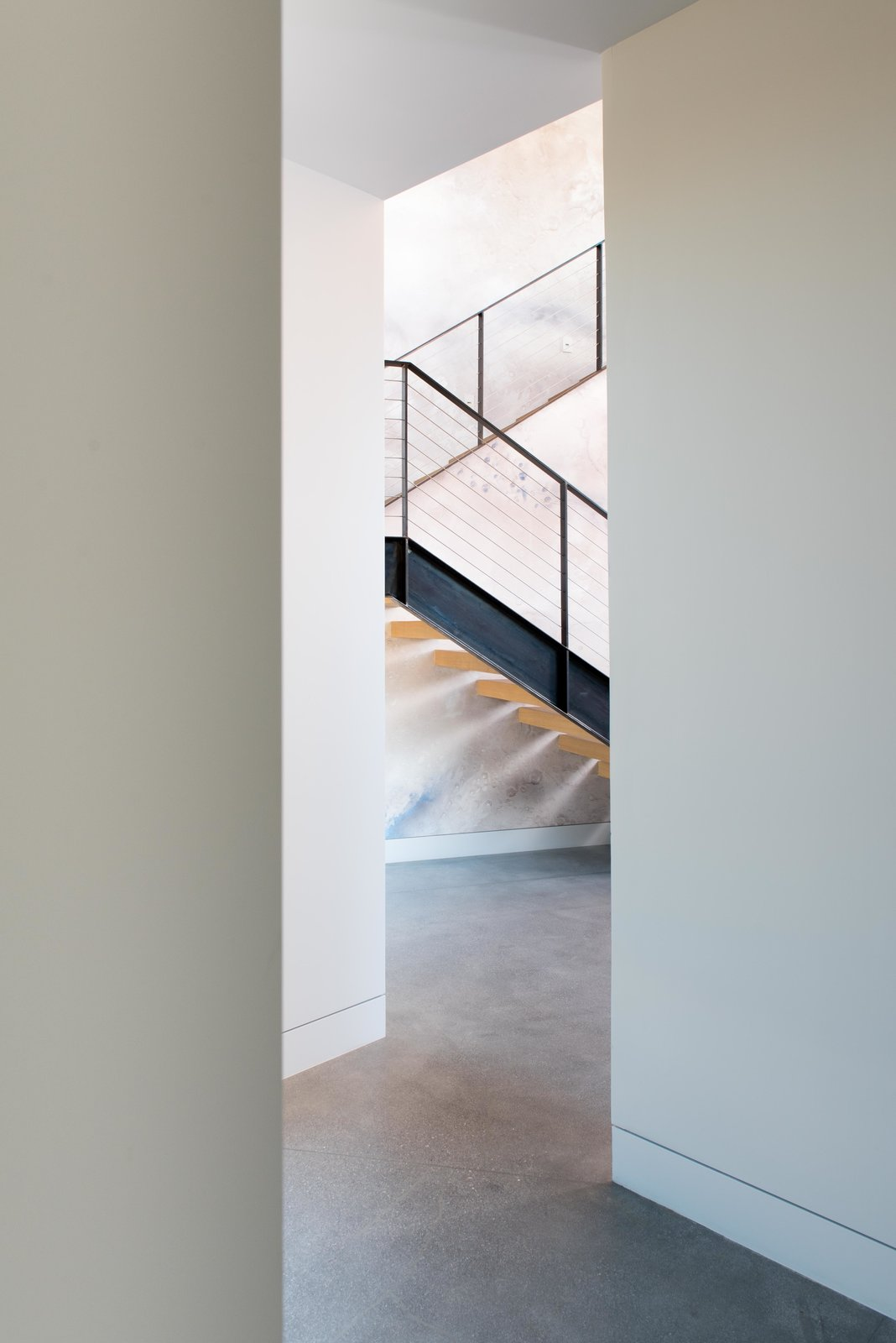 Staircase, Metal, Wood, Cable, and Metal interior stairs with galaxy faux finish wall  Staircase Wood Metal Metal Photos from The Rubber Ducky Trail House
