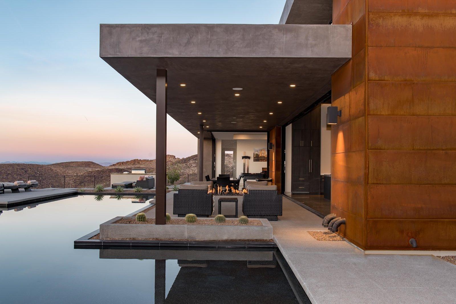 Exterior, House Building Type, Concrete Siding Material, Metal Roof Material, Stone Siding Material, Flat RoofLine, and Metal Siding Material rear exterior twilight   Cloud Chaser