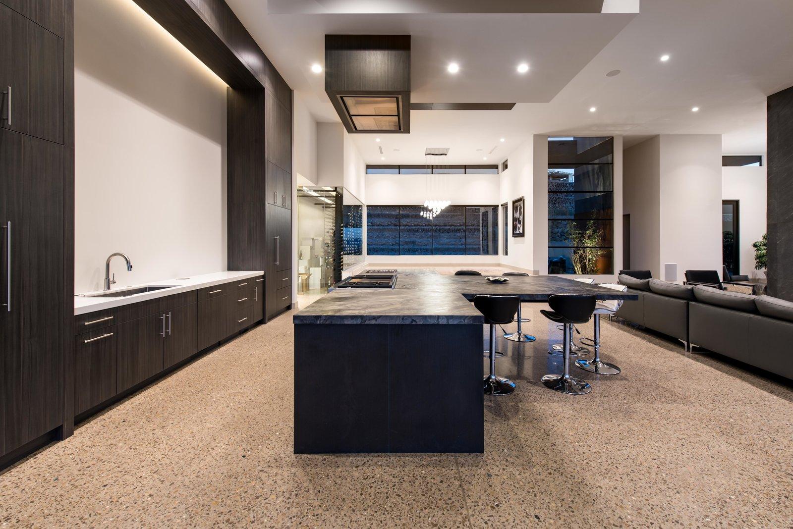 Kitchen, Wood Cabinet, Undermount Sink, Ceiling Lighting, Limestone Floor, Granite Counter, and Refrigerator kitchen   Cloud Chaser