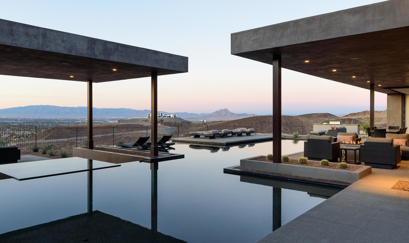 Outdoor, Salt Water Pools, Tubs, Shower, Hardscapes, Large Pools, Tubs, Shower, Infinity Pools, Tubs, Shower, Concrete Patio, Porch, Deck, Back Yard, Swimming Pools, Tubs, Shower, Landscape Lighting, Large Patio, Porch, Deck, Concrete Pools, Tubs, Shower, Vertical Fences, Wall, and Stone Patio, Porch, Deck twilight pool view  Cloud Chaser