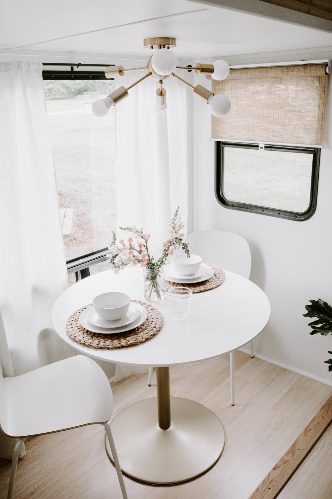 Dining Room, Table, Ceiling Lighting, Light Hardwood Floor, and Chair The couple enjoyed the renovation process so much that they have since launched an RV design and remodeling business called The Arrow Anglers.    The Cougar