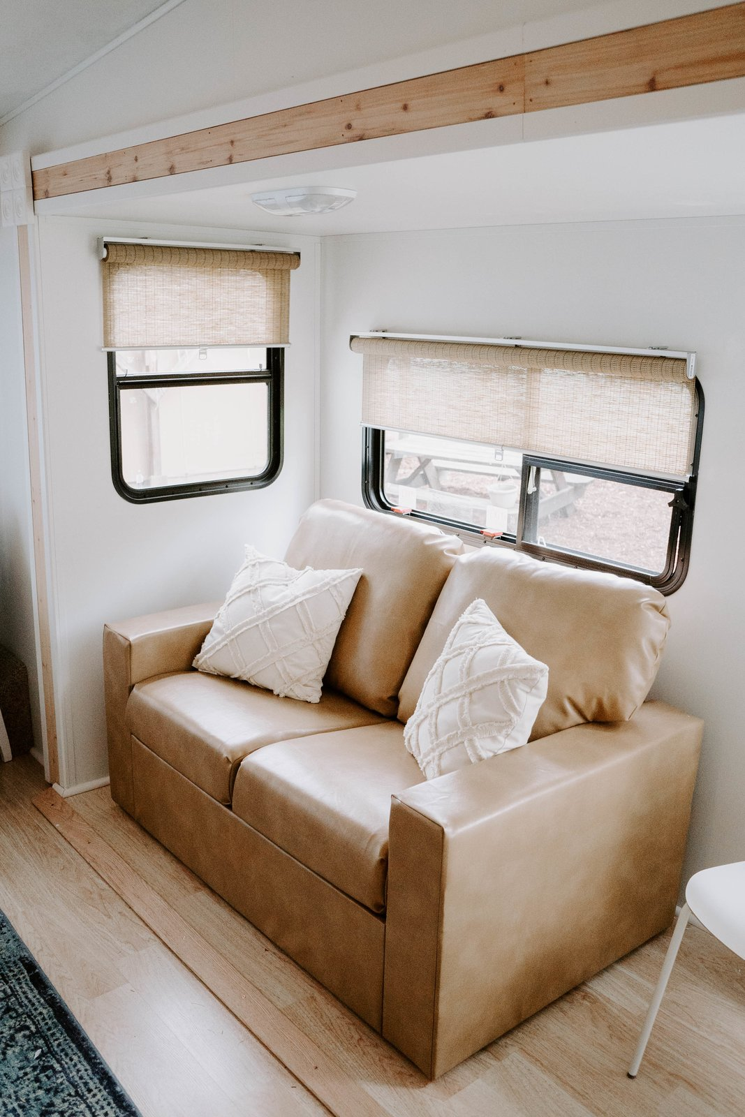 Living Room, Light Hardwood Floor, and Sofa This amazing love seat has storage underneath the seat cushions! Isn't that genius? Especially in a trailer!  The Cougar