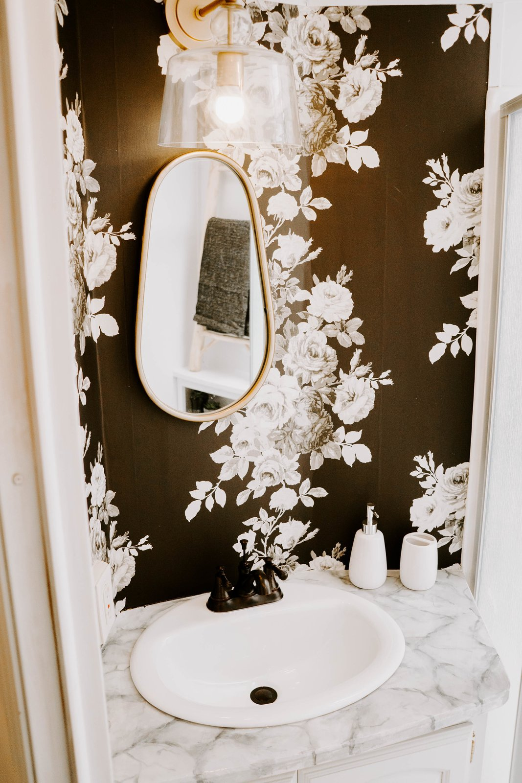 Bath Room, Marble Counter, Enclosed Shower, One Piece Toilet, Corner Shower, Pendant Lighting, Wall Lighting, and Drop In Sink This is what floral wallpaper dreams are made of!  The Cougar