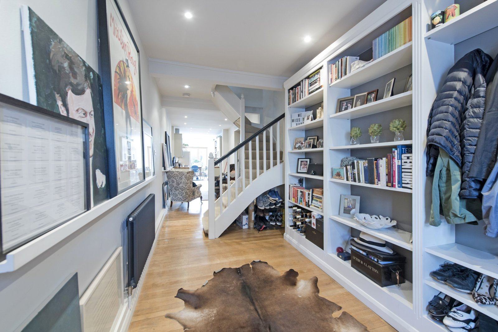 Storage Room and Shelves Storage Type It is possible to see the entire length of the house on the ground floor, increasing the feeling of light and space throughout the home.  Photo 3 of 11 in A Super Skinny London Home Hits the Market at £1M