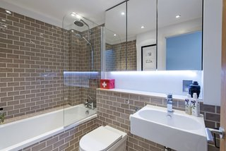 Streamlined, and well-lit, the bathroom is ideally suited to modern life.