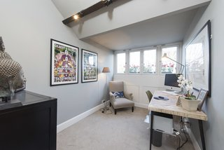 Four windows and a half-vaulted ceiling make a compact space feel spacious.
