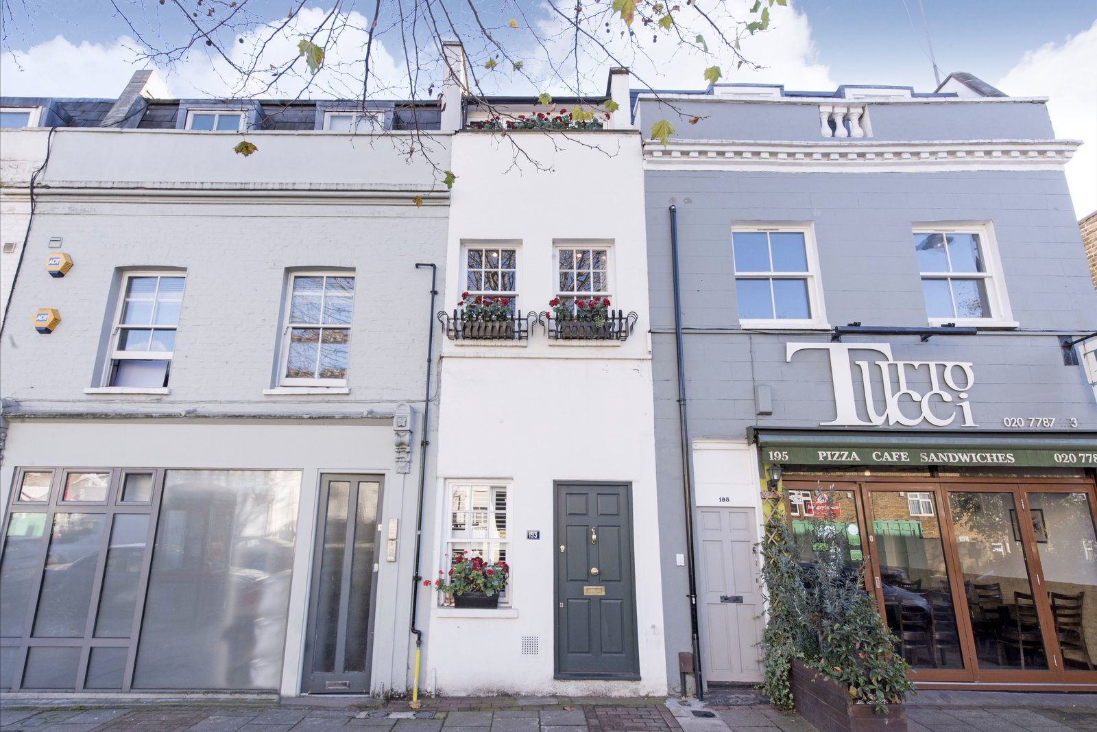 Exterior and House Building Type St John's Hill, where this house is situated, is a bustling, youthful street, with shops, restaurants, and bars.  Photo 2 of 11 in A Super Skinny London Home Hits the Market at £1M