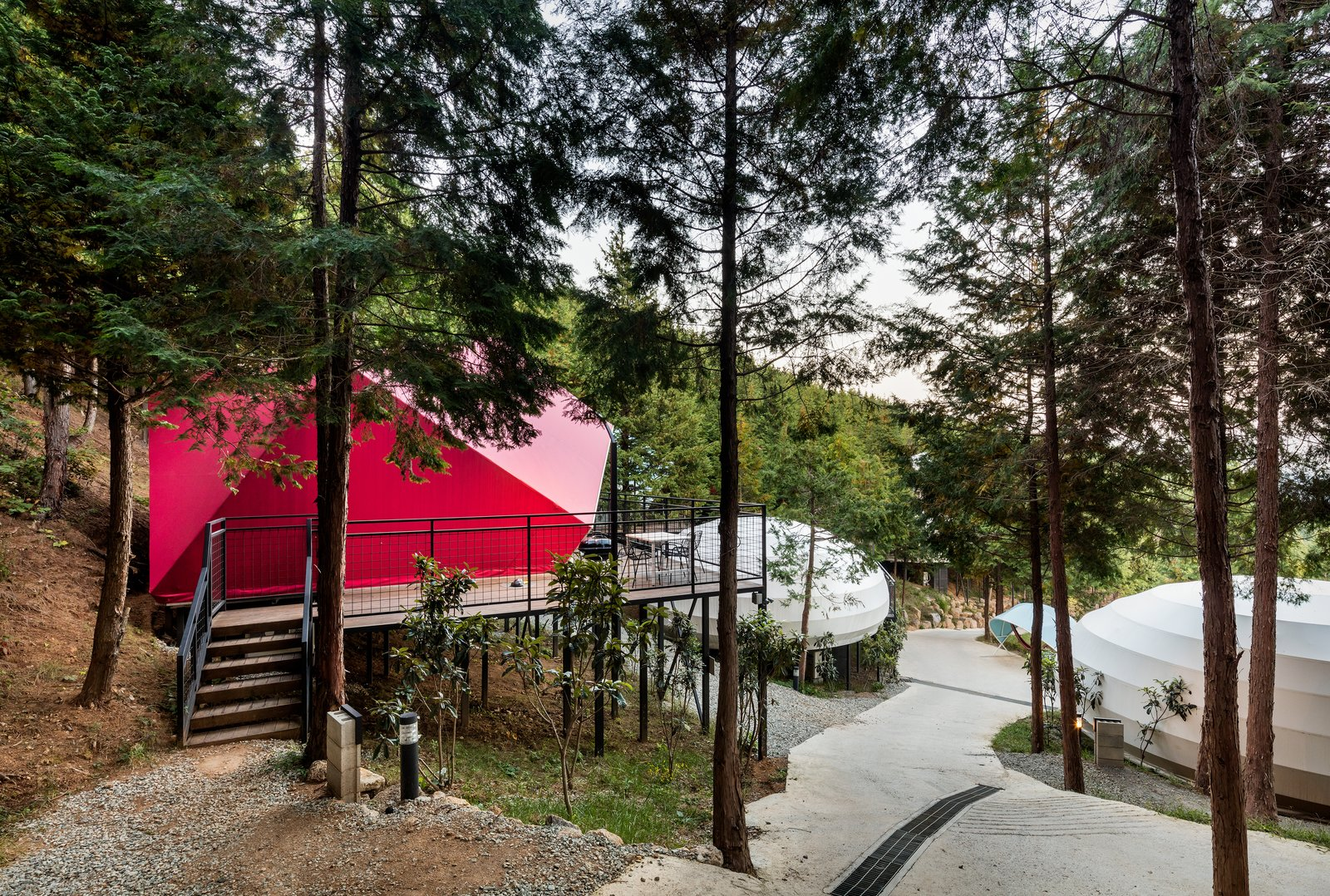 Exterior and Tent Building Type The resort has three types of tents, and each one has its own floor plan and color scheme.  Photo 4 of 7 in Colorful Glamping Pods Dot a Forest in South Korea